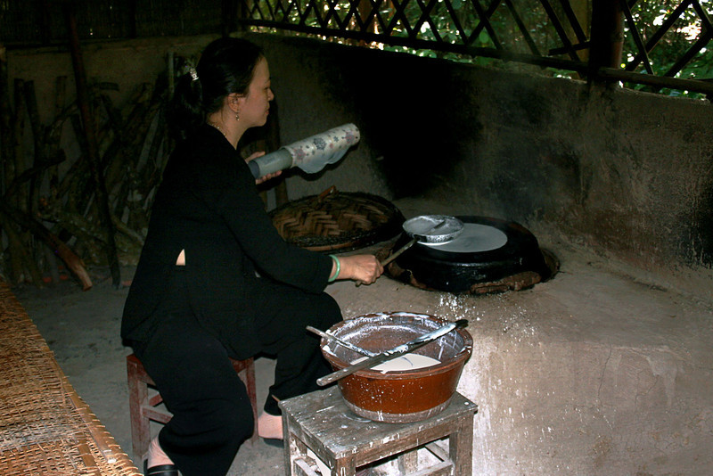 Making rice pancackes, Vietnam