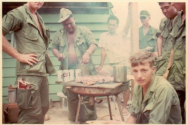 Robert Rowe seated in front, Sergeant Espiritu over the grill, Woody Harano on the right