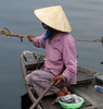 Woman on a boat in Hoi An, Vietnam, in March 2008