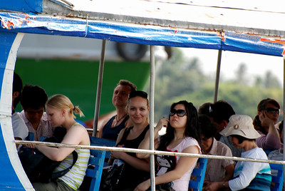 Tourists on a boat in in the Mekong Delta, Vietnam
