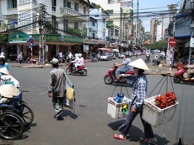 Street scene outside the Bin Tay Market in Saigon, Vietnam, photographed in March 2008