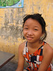 Vietnam, Ho Chi Minh City (Saigon): Young girl sits with us at breakfast.