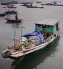Man in Black Shirt, I, Banana Boat, Cat Ba Island, Vietnam