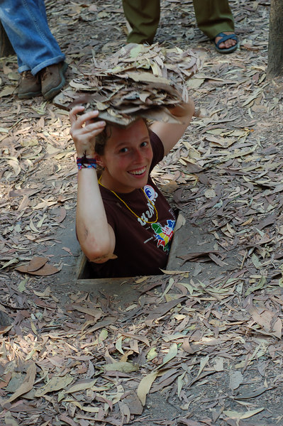 Emilie demonstrates a small entrance to the Cu Chi tunnels
