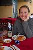 Emilie enjoys a Larue beer and fried wontons.
