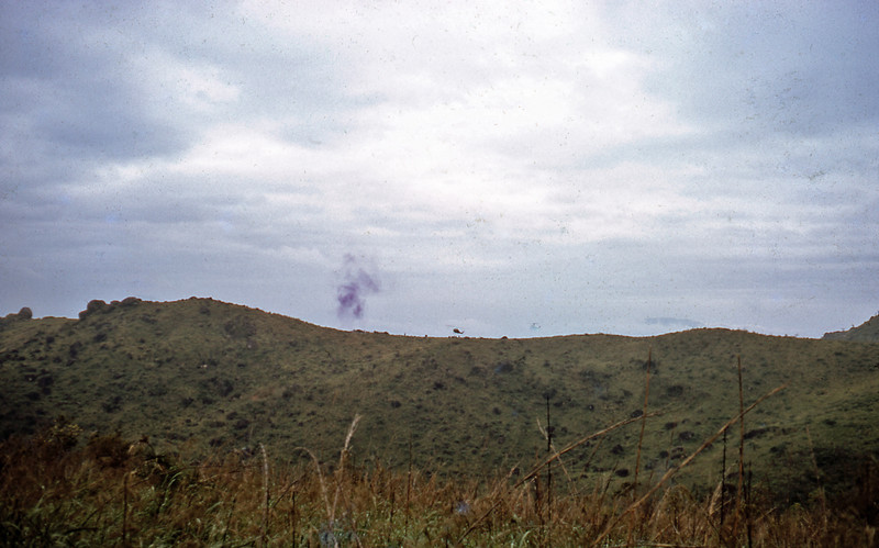 Choppers landing on Charlie Ridge with purple smoke
