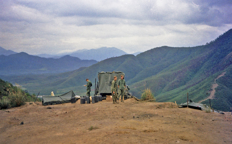 John Fleming on the left, ? and Eccleston on ridgeline outside Da Nang