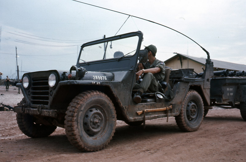 Danny Vasquez in the Company jeep.  In the trailer are recoilless rifles and ammo.  The Easter invasion had started and the NVA invaded with tanks.  Since they hadn't used tanks much before, anti-tank weapons were not in general circulation.  Lower ranking people had to give briefings on how to use them since they had the most recent training.