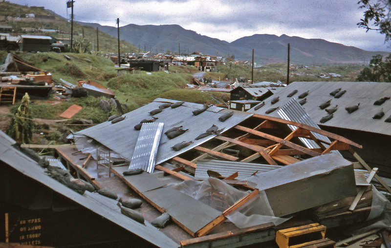 "When typhoon Hester struck Danang I was pulling guard atop Hill 327 where the Air Force had some radar equipment.  My bunker filled up with mud and I had no other safe place to stay on the hill.  When the Air Force captain in charge gave the order to abandon the post, I managed to get on a truck going back.  I took refuge in this hooch, but it blew down soon after.  Only John Fleming (""Preacher Man"") and I were in there and we were saved from injury because someone had stacked all the mattresses in the middle to keep them dry.  The stack prevented the roof from crushing us."