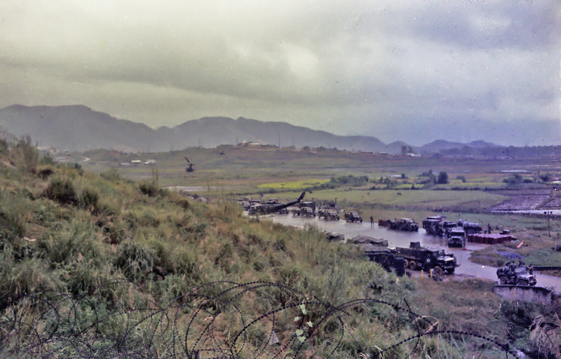 The Camp Reasoner chopper pad.  Right after the typhoon they sent us back to Chu Lai to guard that base as it was being shut down.  Units of the 101st came down to replace us.  This is them being flown out to the bush in the rain.