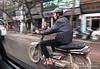 Man on a motorbike in Hanoi, Vietnam in January 2012