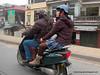 Woman on a motorbike in Hanoi, Vietnam in January 2012