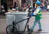 A worker wheeling a very large bin in Hanoi, Vietnam in January 2012