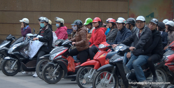 Motorcyclists in Hanoi, Vietnam in January 2012