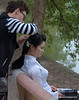 Woman having her hair made up for a wedding photo at the Hoàn Kiếm Lake in Hanoi, Vietnam in January 2012