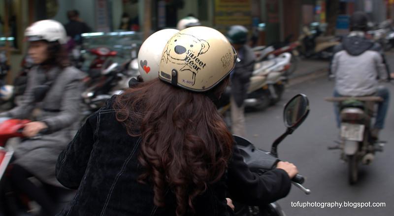 Woman with a sweet bear helmet in Hanoi, Vietnam in January 2012