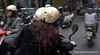 Woman with a sweet bear helmet in Hanoi, Vietnam in January 2012