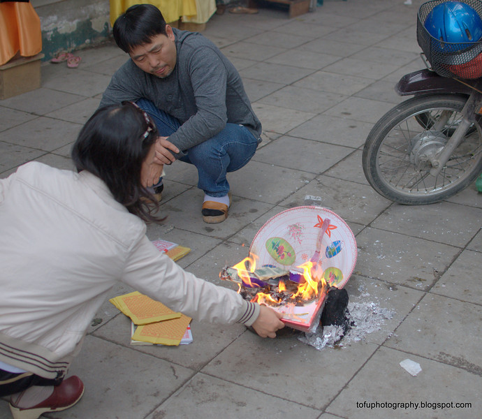Burning paper possessions in anticipation of Tet (New Year) in Hanoi, Vietnam in January 2012