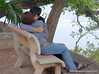 Couple kissing on a park bench by the Hoàn Kiếm Lake in Hanoi, Vietnam in January 2012