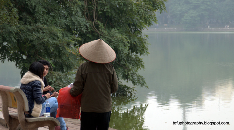 Vietnamese by the Hoan Kiem lake in Hanoi, Vietnam in January 2012