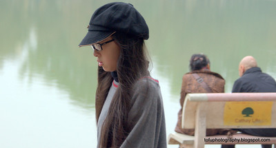 Young woman walking at the Hoàn Kiếm Lake in Hanoi, Vietnam in January 2012