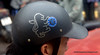 Man with a helmet with an English lion and a Chelsea football club sticker in Hanoi, Vietnam in January 2012