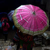 Woman with an umbrella in the market in Sapa, Vietnam in January 2012