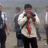 Asian men taking pictures in Sapa, Vietnam in January 2012