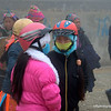 Young women dressed up against the cold  in Sapa, Vietnam in January 2012