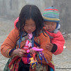 Little girl with a baby on her back in Sapa, Vietnam in January 2012