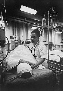 A nurse tends to a patient just out of surgery in the intensive care ward of the hospital ship USS Repose, October, 1967.
