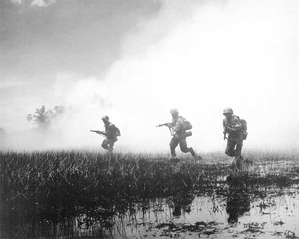 South Vietnamese troops in combat against communist guerrillas of the Viet Cong.