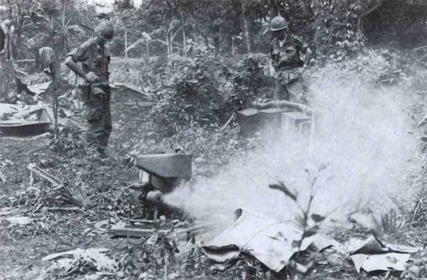 Engineers unpack and test a Mitey-Mite blower in the jungles of Vietnam. It would aerosolize and disperse CS powder, smoke, or riot-control agents, helping clear Viet Cong out of tunnels.