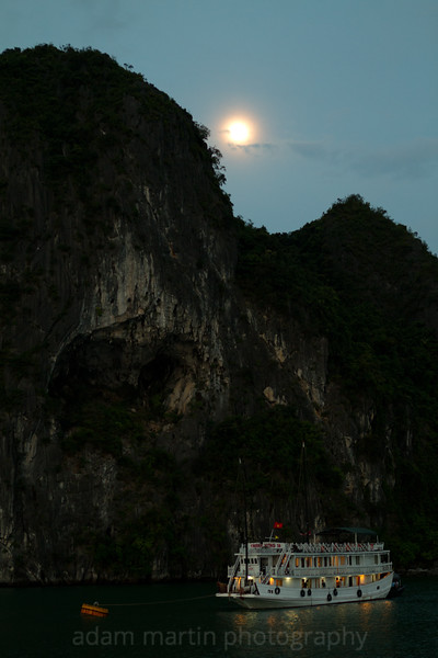 A fuzzy moon over Halong Bay Vietnam.