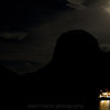A moon a boat and an island hummock. Halong Bay Vietnam