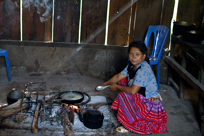 The kitchen and the cook at the homestay in Hang Kia Village Vietnam.