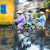 That same day, then the rain subsided but the streets were still wet, we ventured out onto the street and continued to photograph the locals riding in their pastel ponchos.