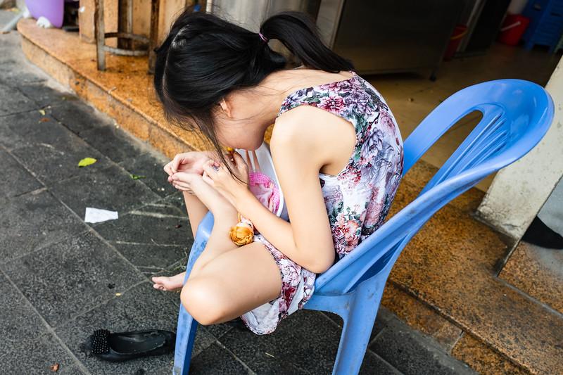 Girl with doll. Hanoi, Vietnam