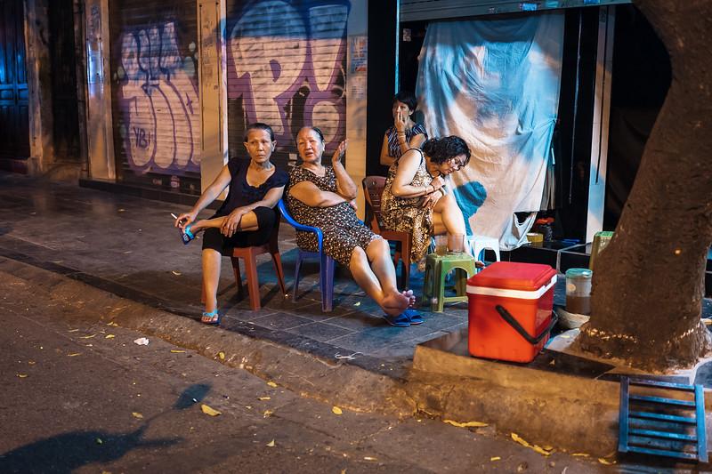 Ladies on the block. Hanoi, Vietnam