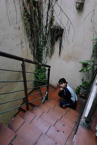 Eileen in the cafe stairwell. Hanoi, Vietnam