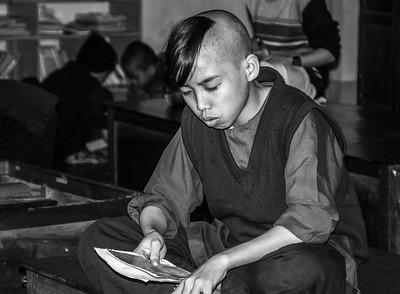 A young boy studies to become a Buddhist monk@