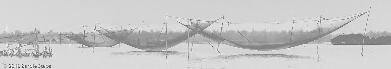 Fishing nets on the river - solarized effect on image