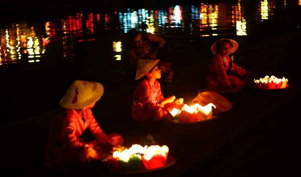 Floating candles at the Thu Bon River in Hoi An, Vietnam.