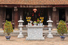 An altar and gifts at an historic old buddhist temple in Haiphong, Vietnam, Asia.