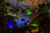 The Hang Dau Go cave illuminated with colored lights in Ha Long Bay, Vietnam, Asia.