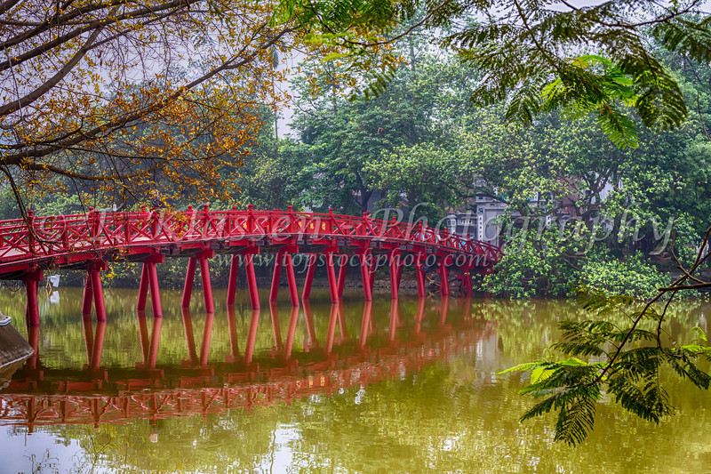 The picturesque Huc Bridge on Hoan Kiem Lake, Hanoi, Vietnam, Asia.