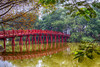 The picturesque Huc Bridge on Hoan Kiem Lake, Hanoi, Vietnam, Asia.