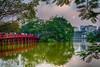 Hoan Kiem Lake and reflections of the Huc Bridge in Hanoi, Vietnam, Asia.