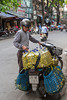 A motorbike delivery vehicle on the street in Hanoi, Vietnam, Asia.