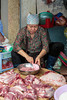 An informal outdoor butcher shop cutting meat on the streets in Hanoi, Vietnam, Asia.